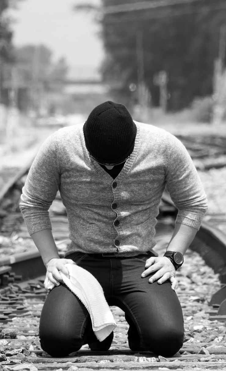 black and white guy kneeling man